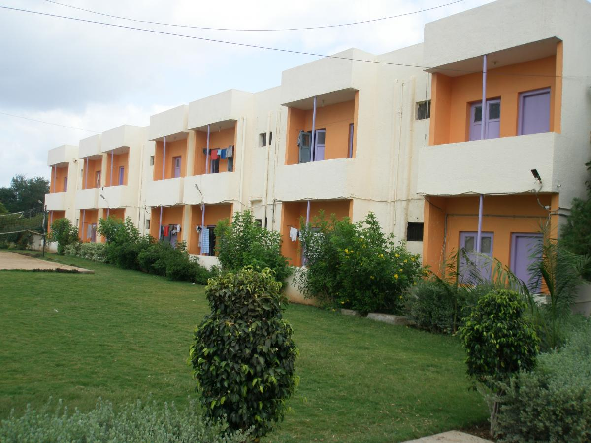Darshan Hostel - Rooms building with Sports play area